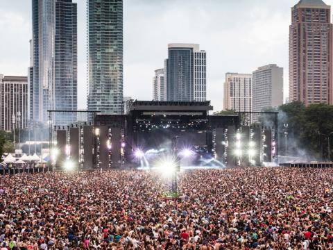 Watching a live performance with the Chicago skyline as a backdrop at Lollapalooza