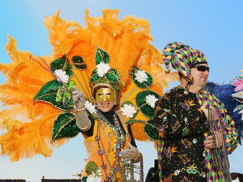 Throwing beads to the crowd during Lake Charles Mardi Gras